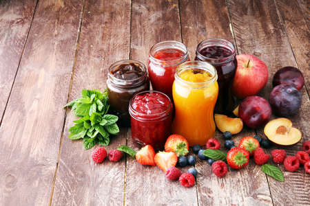 assortment of jams, seasonal berries, plums, mint and fruits Stock fotó - 90036361