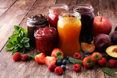 assortment of jams, seasonal berries, plums, mint and fruits