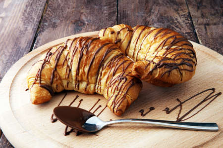 Fresh homemade croissants with chocolate. Sweet bakery concept.