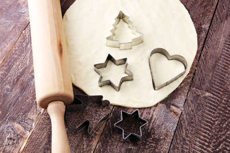 Christmas baking ingredients and tolls for dough preparation. Flour, rolling pin and cookie cutters. Stok Fotoğraf