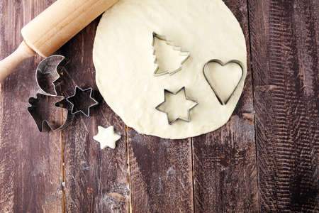 Christmas baking ingredients and tolls for dough preparation. Flour, rolling pin and cookie cutters. Stock fotó