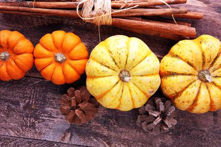 Autumn Pumpkin Thanksgiving Background orange pumpkins over table. Фото со стока