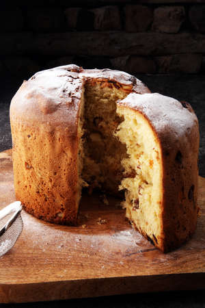 Classic panettone with dried fruit ,traditional Italian Christmas cake Stock Photo - 91235054