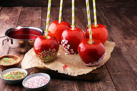 Sugar apple with red icing. Sweets paradise apple on market in Germany. Sweet candy Apple