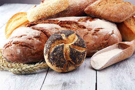 Different kinds of bread and bread rolls on white board. Kitchen or bakery poster design