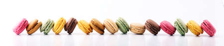 Sweet and colourful french macaroons or macaron on white background, Dessert Stock Photo