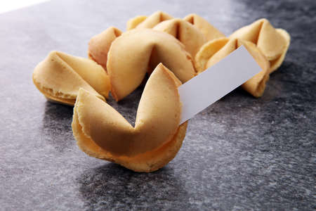 Fortune Cookies with blank paper on dark background