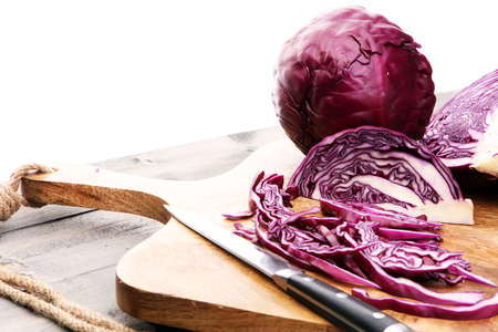 Shredded cabbage, red cabbage on wooden cutting board