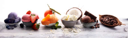 Set of ice cream scoops of different colors and flavours with berries, nuts and fruits  스톡 콘텐츠