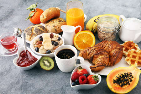 Breakfast served with coffee, orange juice, croissants and fruits. Balanced diet. Фото со стока