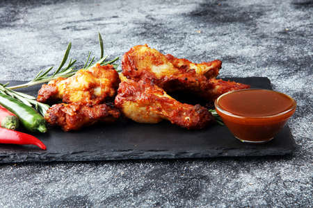 Crispy barbecue chicken wings bbq on grey background