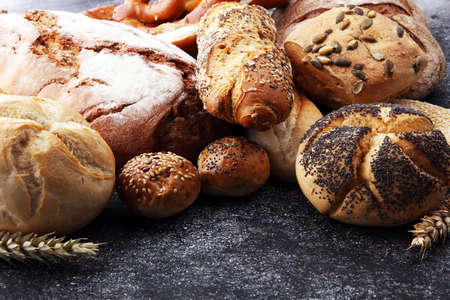 Different kinds of bread and bread rolls. Kitchen or bakery poster design Stock Photo