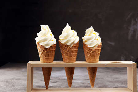 Vanilla frozen yogurt or soft ice cream in waffle cone