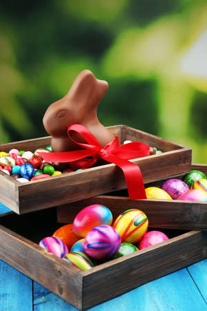 Chocolate Easter eggs and chocolate bunny and colorful sweets Stock Photo