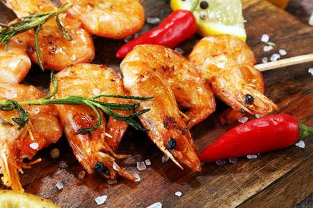 Grilled shrimp skewers. Seafood, shelfish. Shrimps Prawns skewers with herbs, garlic and lemon. Barbecue srimps prawns.
