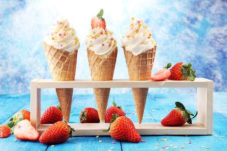 Vanilla frozen yogurt or soft ice cream in waffle cone