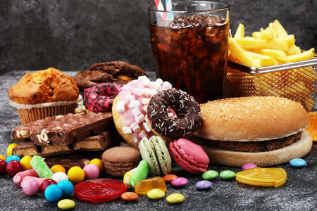 Unhealthy Products. Food Bad For Figure, Skin, Heart And Teeth... Stock Photo, Picture And Royalty Free Image. Image 97265223.