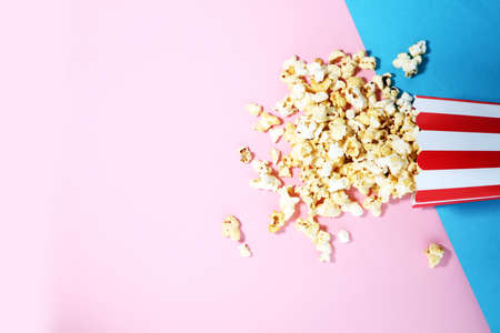 Salt popcorn or sweet popcorn flat lay on colored paper