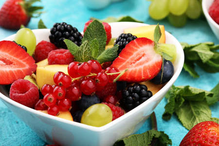 salad with fresh fruits and berries. healthy spring fruit salad  Stock Photo
