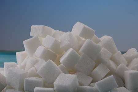sugar cubes. unhealthy living with white crystal sugar cube Standard-Bild
