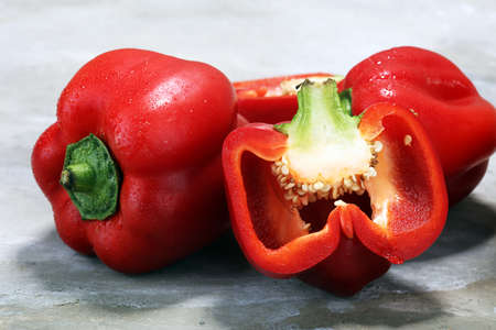 Fresh red bell pepper on grey background. raw vegetable.