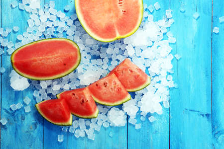 watermelon on blue background. juicy summer fruit in slices. Archivio Fotografico