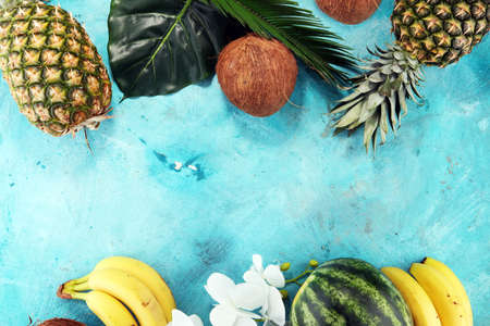 Tropical fruits background with pineapple, banana, coconut and watermelon.