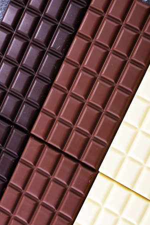 chocolate in diffrent color. milk, dark and white chocolate bars.