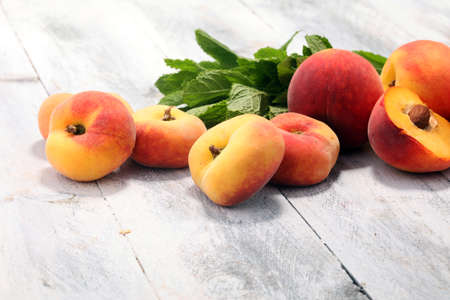 A group of ripe peaches on table. Fresh peach concept