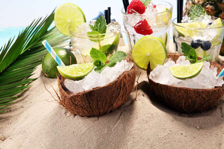 Different types of mojito cocktail on the beach