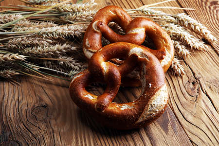 German pretzels with salt close-up on the table. 免版税图像