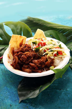 Nasi Campur Bali. Popular Balinese meal of rice with meat. Typical Malaysian street food lunch mixed rice