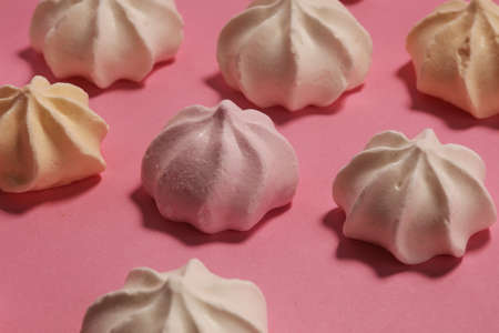 Meringue. Crispy white and pink twisted meringue. Concept love of sweet