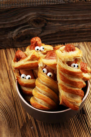 Mummy sausages scary halloween party food decoration wrapped in dough