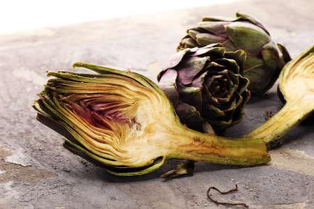 artichokes on grey background. fresh organic artichoke flower Stock Photo