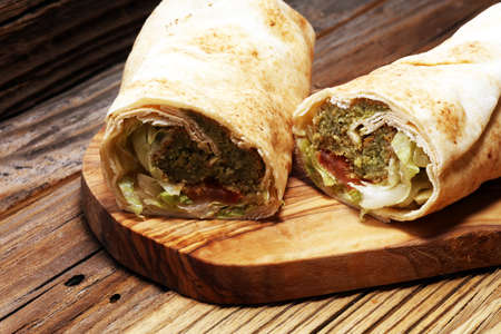Green falafel with hummus and vegetables in pita bread. Love for a healthy vegan food concept