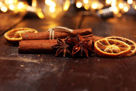 Fragrant star anise and cinnamon on wooden table.