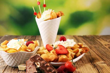 Hong Kong style egg waffle. bubble waffle with sundae ice cream and fruits. street food waffles
