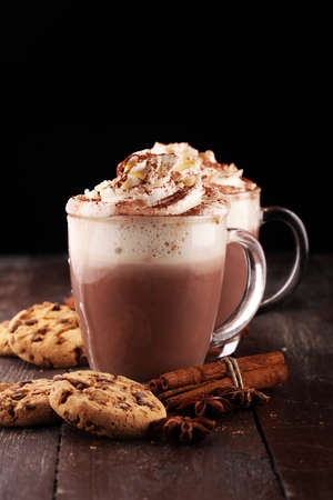 Hot chocolate cocoa with whipped cream on table Imagens