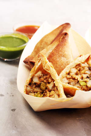 Vegetarian samsa or samosas.Indian special traditional street food punjabi samosa or Coxinha, Croquete and other Fried Brazilian Snacks. Stock Photo