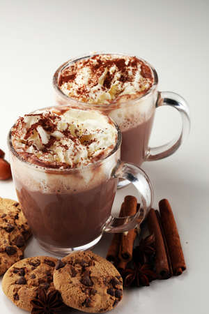 Hot chocolate cocoa with whipped cream on table Stock Photo