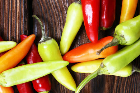 Pepper. Mexican hot chili peppers colorful mix habanero poblano serrano jalapeno on wood
