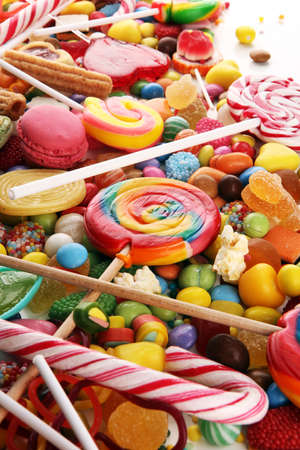 candies with jelly and sugar. colorful array of different childs sweets and treats