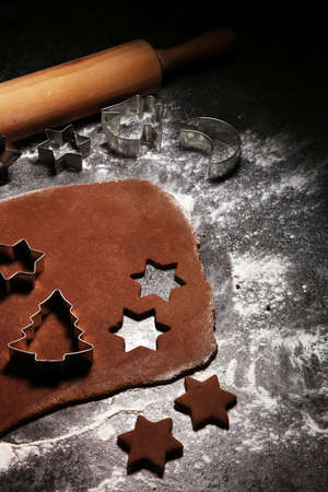Baking christmas cookies. Typical cinnamon stars bakery for xmas with ingredients 免版税图像