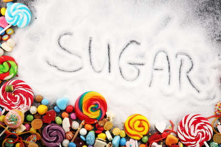 Diet and weight loss, denial of sweet. sugar text with concept. Sugar description in black. sweets. Diabetes problems, harm from eating, dependence on flavoring. Pain in the teeth, caries