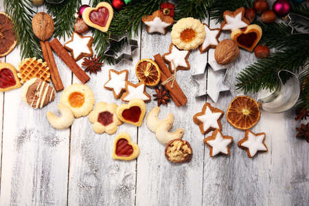 Baking christmas cookies. Typical cinnamon stars bakery for xmas with ingredients Reklamní fotografie