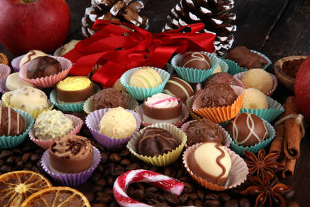 a lot of variety chocolate pralines, belgian confectionery gourmet chocolate and christmas spices with apples.