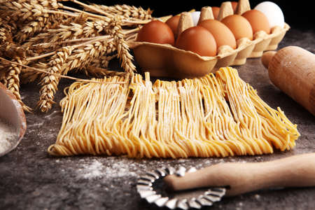 pasta. Fresh homemade pasta with pasta ingredients on the rustic table Reklamní fotografie