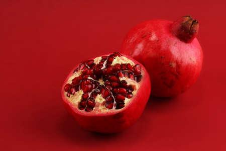 Ripe Pomegranates. sliced and whole pomegranate on a table