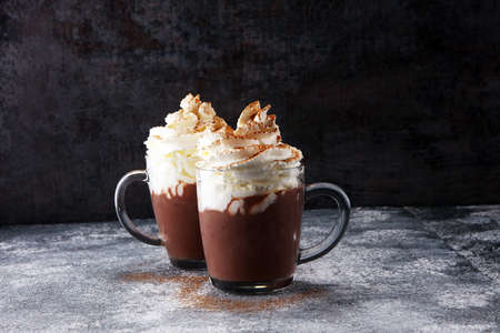 Hot chocolate cocoa with whipped cream for xmas on table.